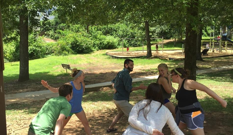 Pro Bono Board Members unwind with a game during the annual retreat.