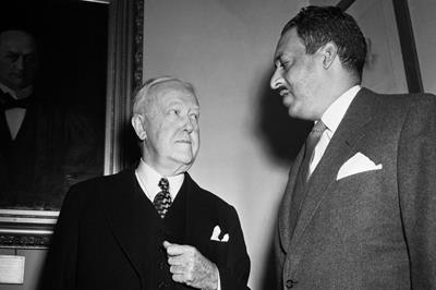 Thurgood Marshall (right) argued before the Supreme Court on behalf of the plaintiffs in Briggs, while John W. Davis (left) argued on behalf of the defendant school district. ©NAACP LDF.