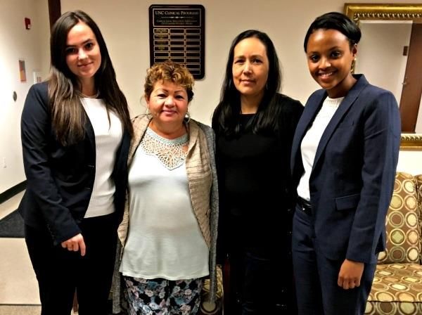 Civil Clinic Students Kaylan Meaza and Rhian Mayhew pose with Clients after successful mediation
