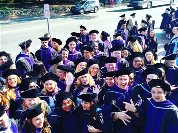 Members of the Class of 2018 gather outside Carmichael Arena for Commencement